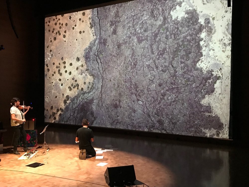 THERE IS A RIVER THERE. Performance commission for   The Institute for Contemporary Art - Virginia Commonwealth University Richmond VA, 2018.  Live collaboration between Laura Ortman and Demian DinéYazhi´, Artistic production by Cannupa Hanska Luger, with video direction by Dylan McLaughlin and Cannupa Hanska Luger.