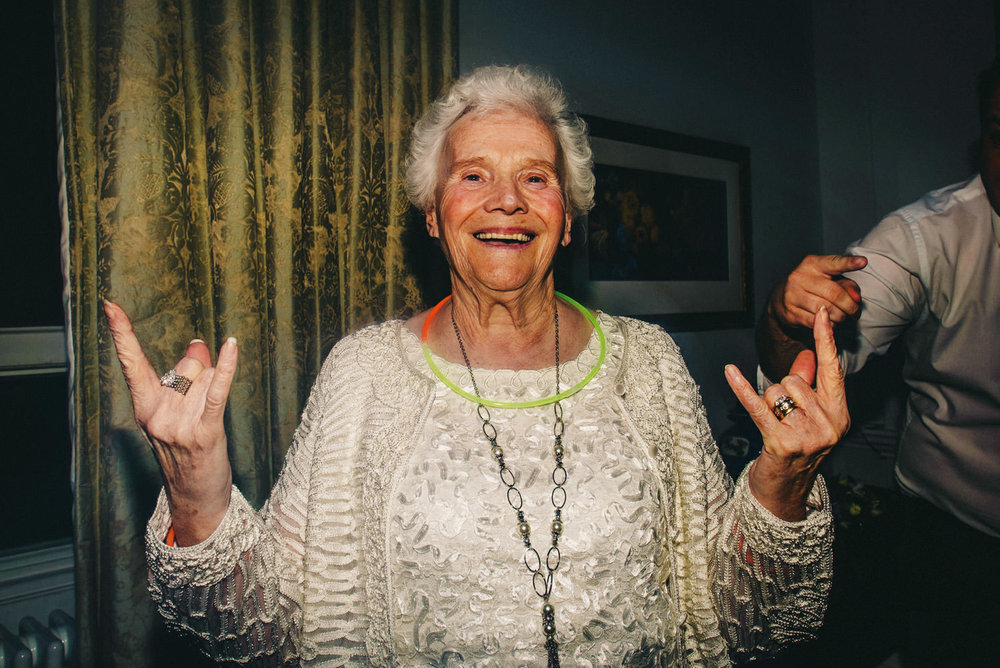 Old Lady doing rock hand sign