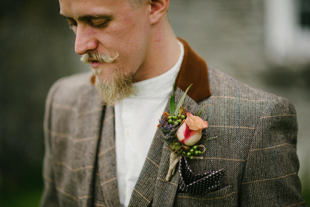 Cool alternative groom with no tie
