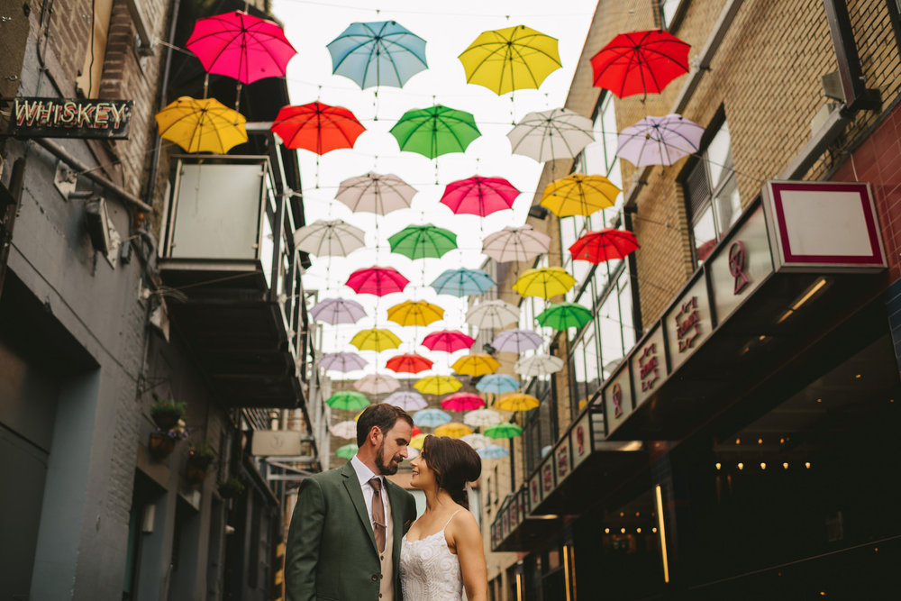 Dublin City Wedding underneath multi coloured umbrellas. Wedding Photos in Dublin.