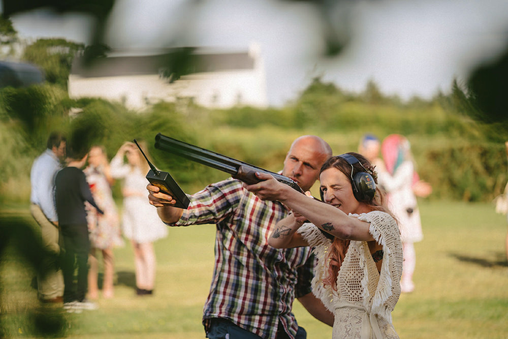 Alternative Wedding lawn games ideas. Clay Pigeon Shooting. Axe Throwing.