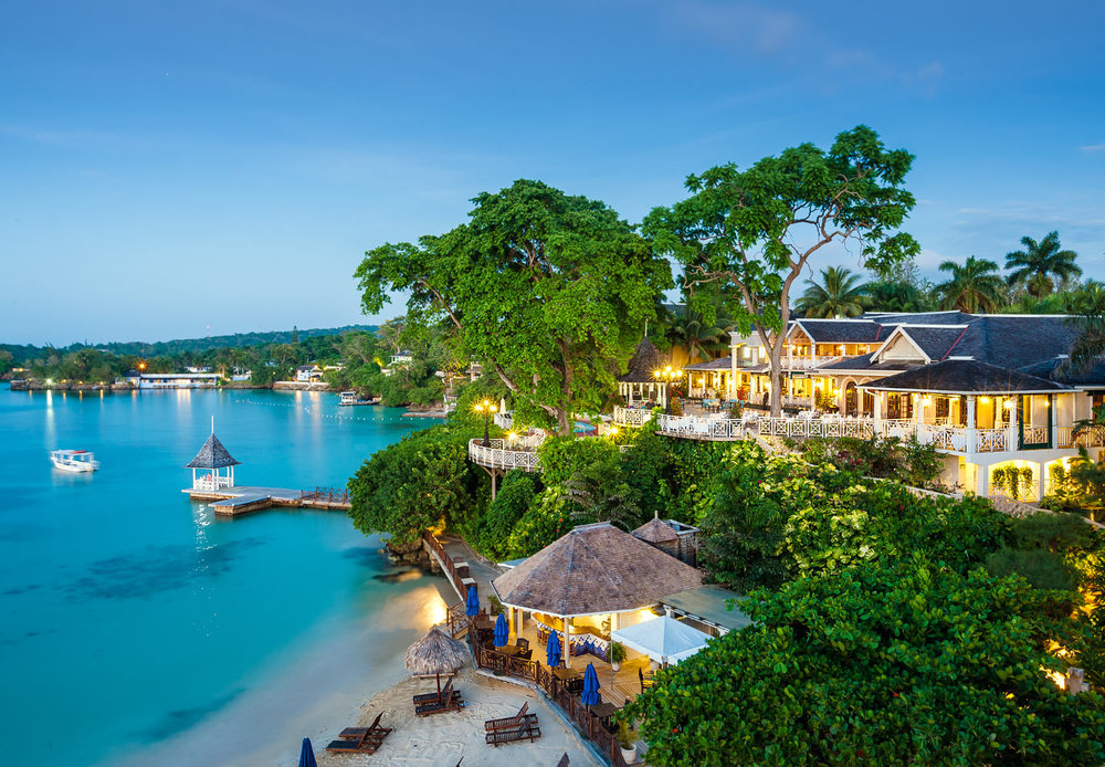 Understated elegance and exquisitely private, this is Sandals Royal Plantation - an intimate all-butler resort of just 74 ocean view suites tucked into a magnificent coral bluff. You can spend your days lazing by the pool with cool libations delivered right to you by a beach butler. Tee off at nearby Sandals Golf & Country Club, followed by a spot of afternoon tea on the terrace. Renowned for unmatched attention to detail, this enclave of retro-chic sophistication showcases roaming peacocks and manicured lawns. This historic resort has long been a favorite hideaway for the international jet set and literary elite, with the likes of Ian Fleming and Noel Coward seeking tis casual island elegance and authentic Jamaican vibe back in their day. Today, exquisite original furnishings and new innovations - like Jamaica's only champagne and caviar bar - are designed to impress.