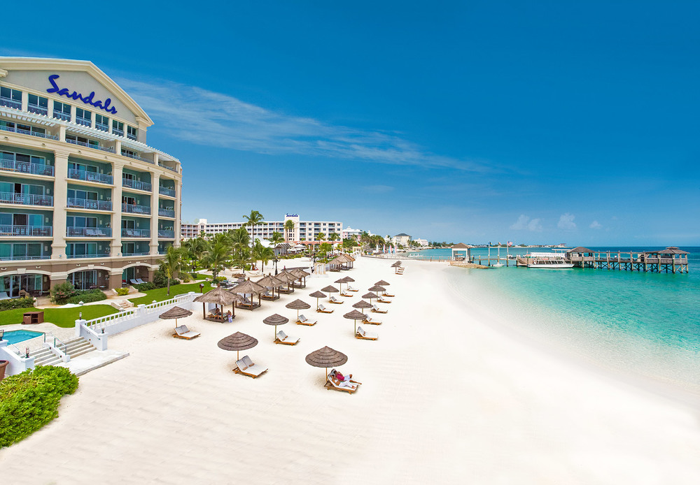 Tucked away in a serene corner of the world on a chain of 700 islands known as the Bahamas lies a retreat so alluring, it was once the private club for 1940's high society such as the Duke and Duchess of Windsor, and later a hideaway for celebrities-including The Beatles while they were filming Help!. Today, Sandals Royal Bahamian is the Bahamas' most elegant resort, offering two unique destinations in one. Enjoy all inclusive Bahamas vacations at this luxurious resort, featuring its own offshore island filled with every amenity, romantic adventures, and the region's finest seafood restaurant. A refined mainland is filled with European sophistication and extravagant details, from Roman colonnaded pools and exotic firepits, to ten other restaurants and a   world-class spa.