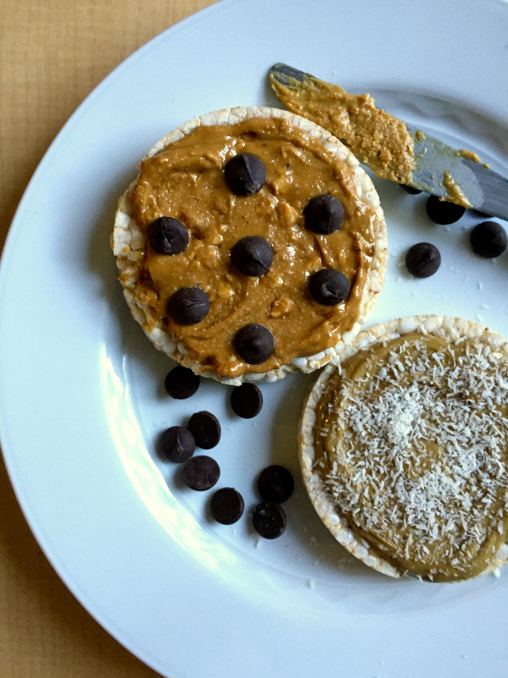 brown-rice rice cakes + natural PB + shredded coconut + dark chocolate chips