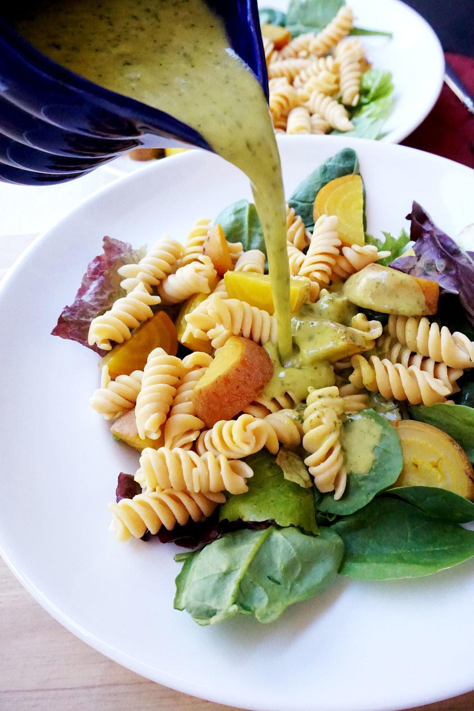 beet pasta dressing pour.jpg