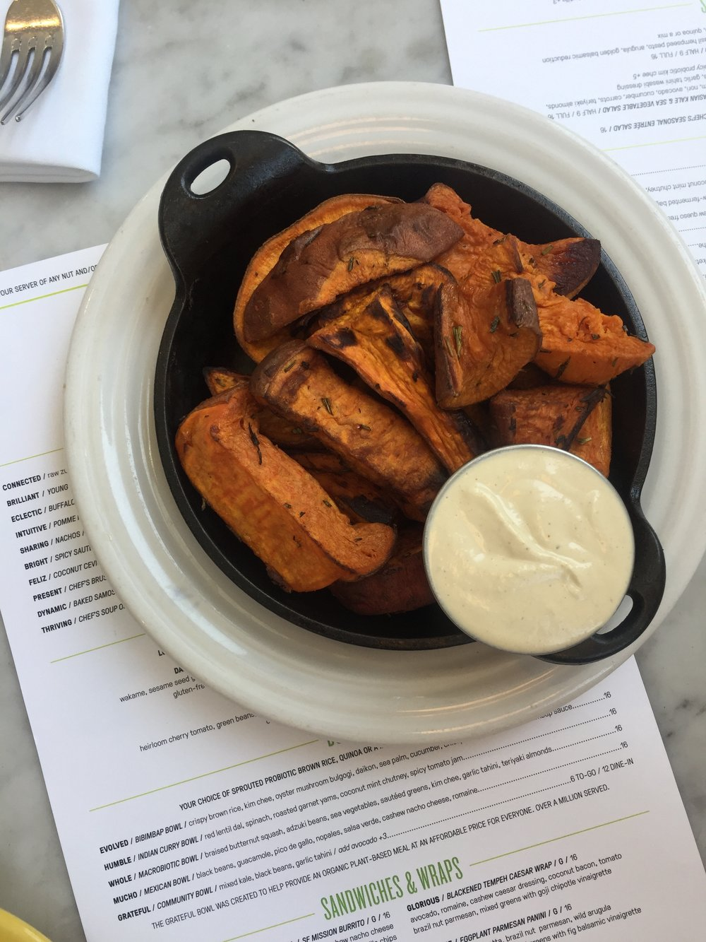 roasted sweet potato wedges + cashew cream sauce from Cafe Gratitude