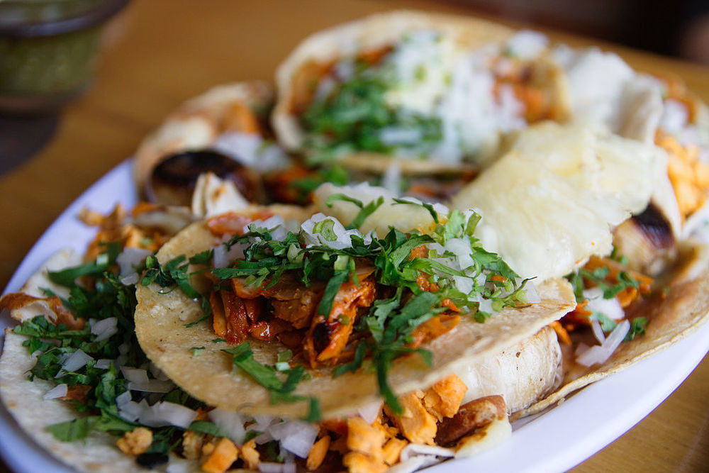 "Photo: ""01 Tacos al Pastor"" by William Neuheisel - Flickr: Tacos al Pastor. Licensed under CC BY 2.0 via Wikimedia Commons."