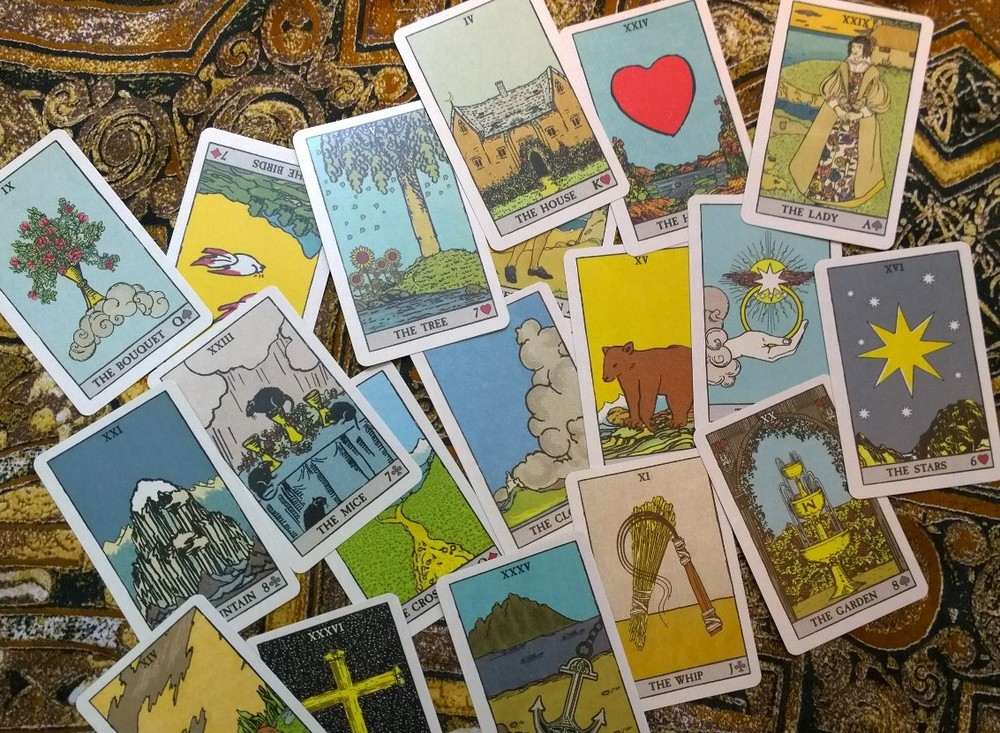 Cards from  Pixie's Astounding Lenormand  by Edmund Zebrowski.