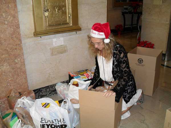 Our volunteer host, Brenda, organizing 600 pounds of food in the lobby of the Harvey Building at the 2012 Holiday Open House.