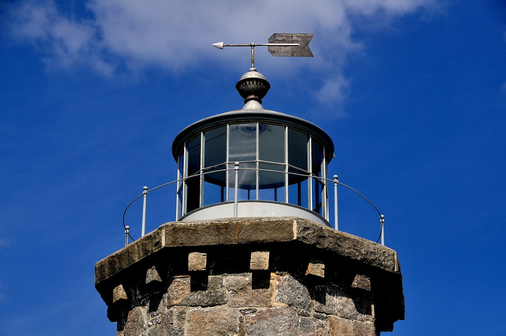 Stonington, Connecticut - July 10, 2015:  Weathervane and former glassed in light at the 1840 granite Old Lighthouse Museum on the East Side of Stonington Harbor