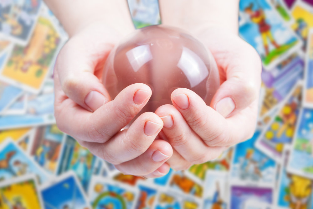 Hands holding magic crystal ball.