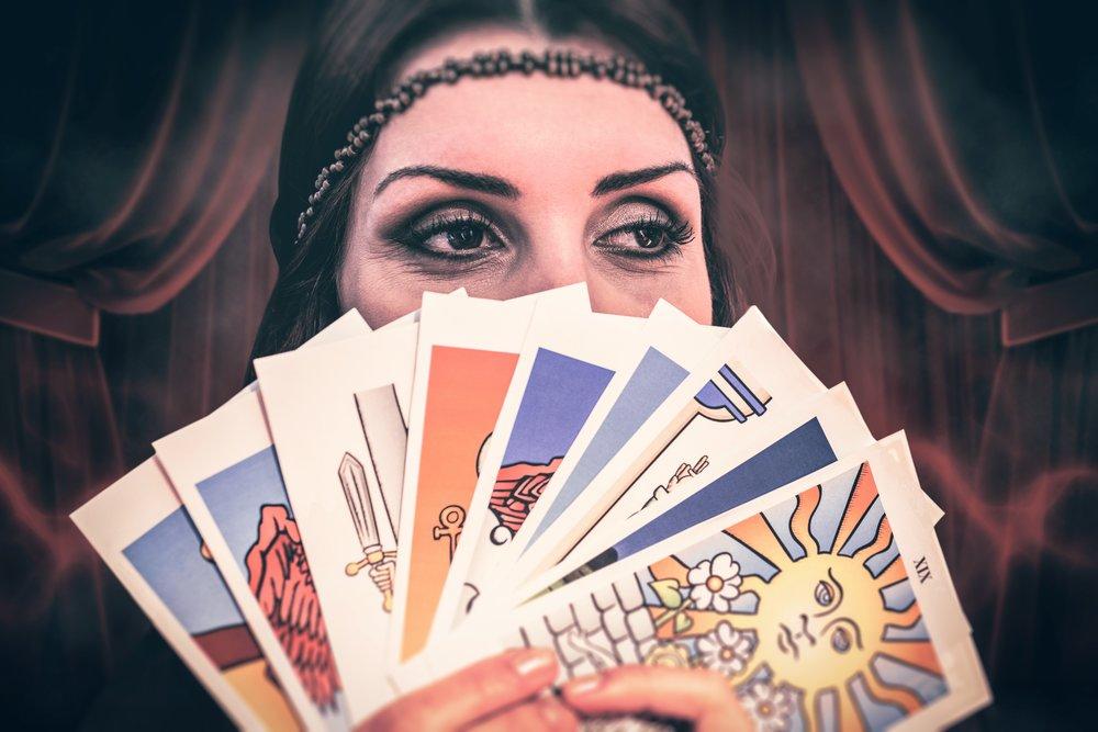 Fortune teller holding tarot cards
