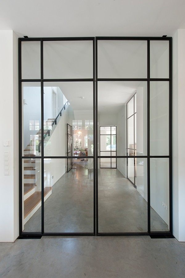 Slim black frame glass door - looks amazing but imagine where to put a lock here. No where!