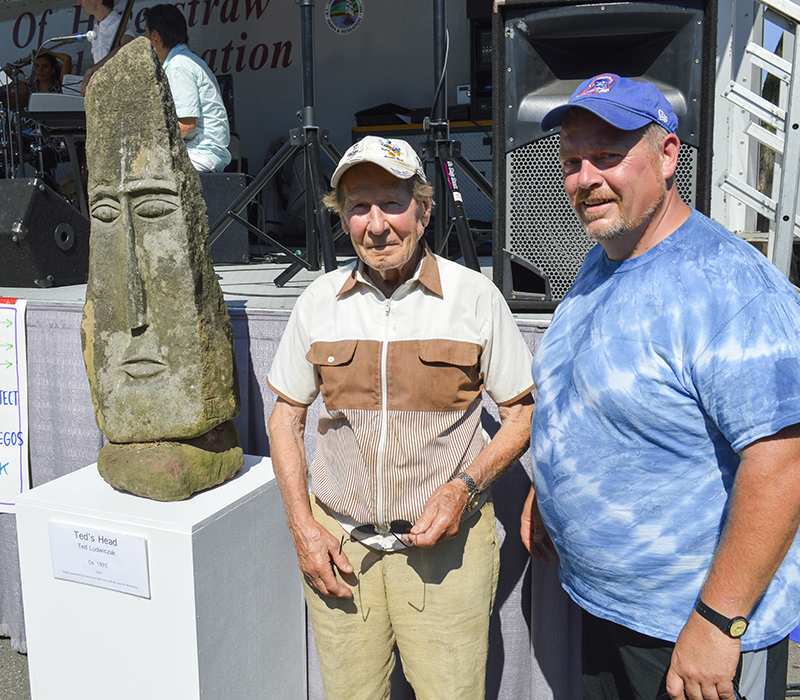"Mayor Mike Kohut and Ted Ludwiczak, Village of Haverstraw Sculptor, who donated a stone sculpture named ""Ted's Heads."" The sculpture will be permanently showcased in Emeline Park."