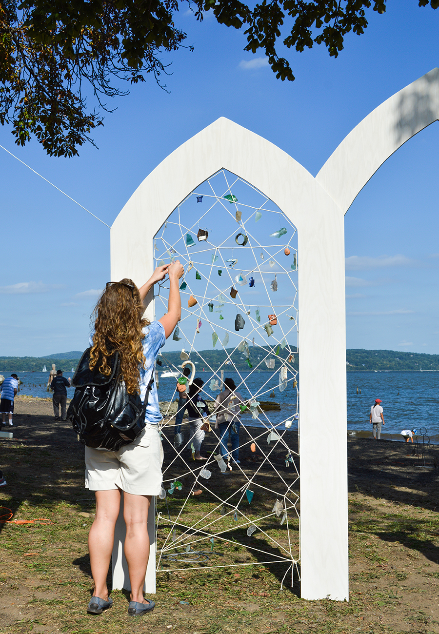 Haverstraw RiverArts committee member Rachel Rohr adding a piece to this interactive sculpture created by Eileen Leith and Kerri Lee Green