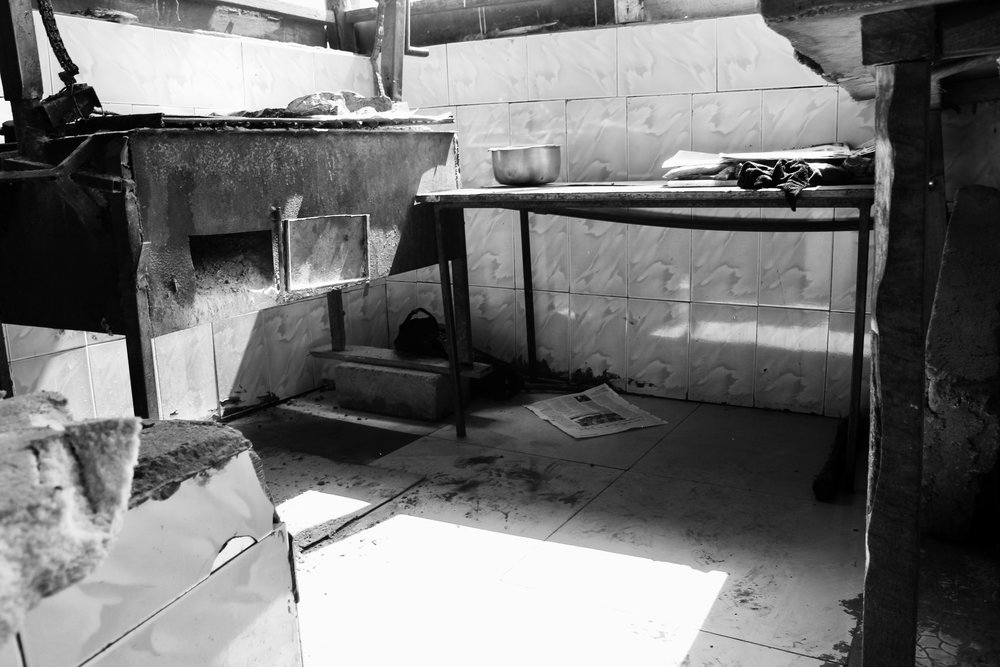 Where some of the street boys sleep. Though it is hard to tell from this photo this area is open air (it is in the outside portion of the butchery).