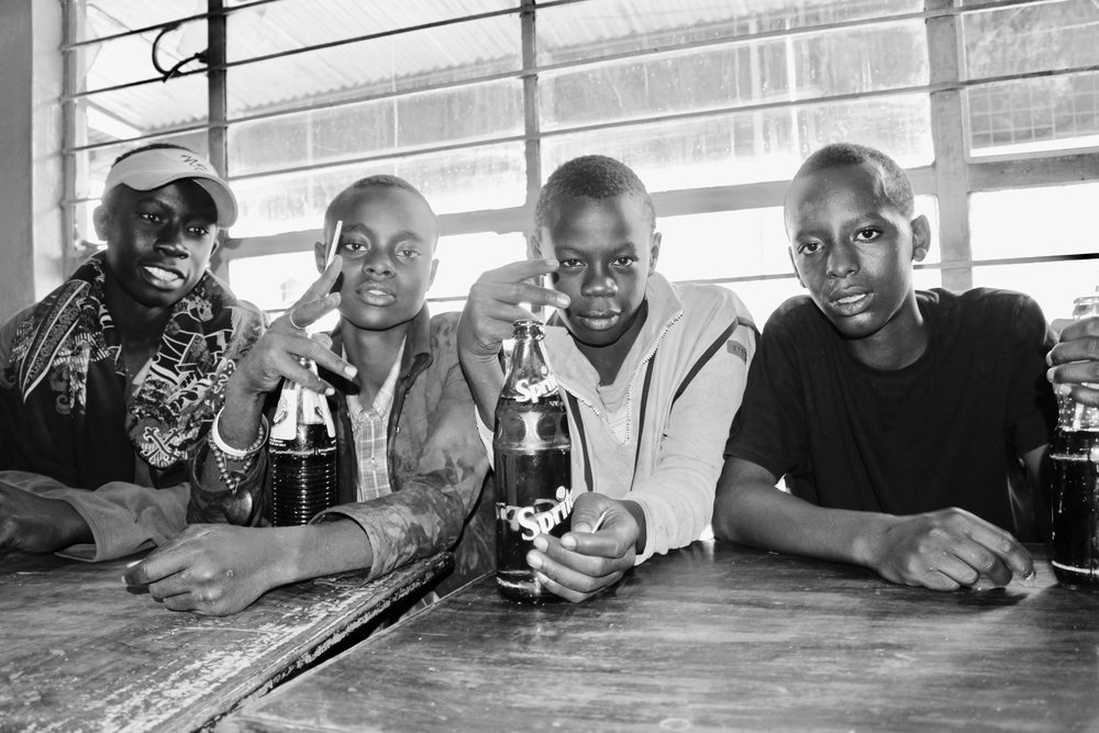 Boniface is on the far right. He is now in my home. The other three (from right to left: Melvin, Cain, and Victor) still sleep at the butchery.