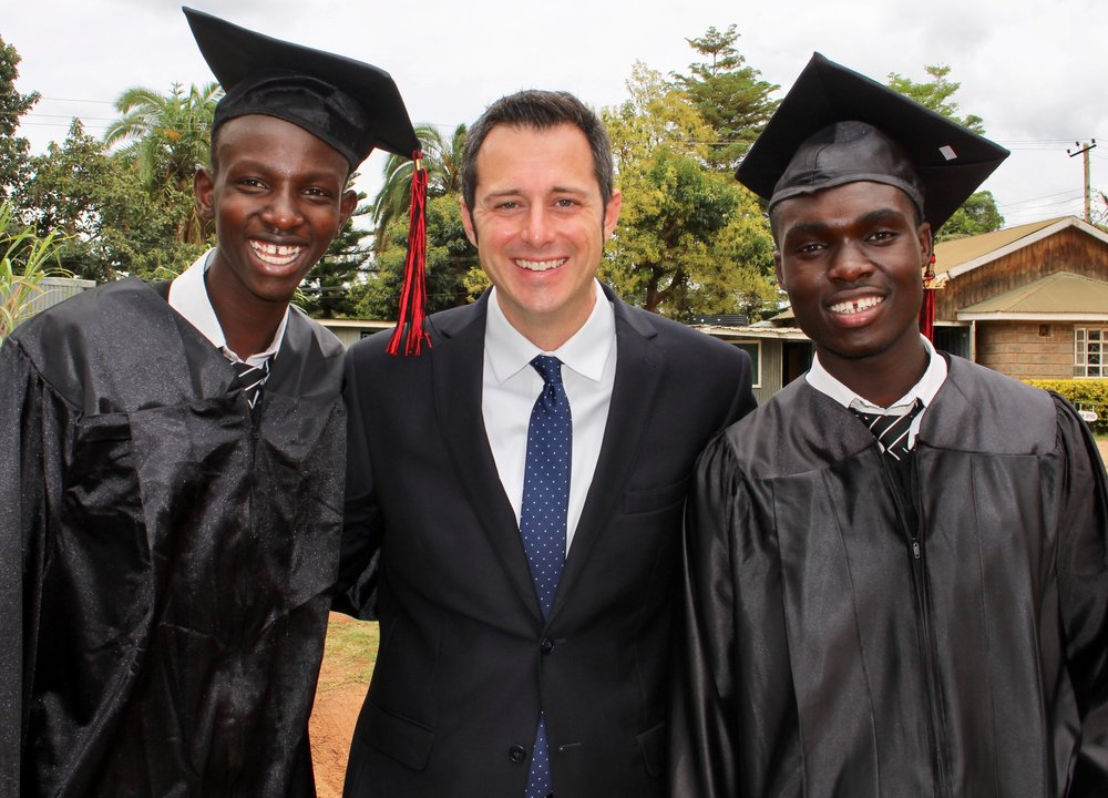 [Graduation Day:  Julius is on my left and Vincent is on my right.]