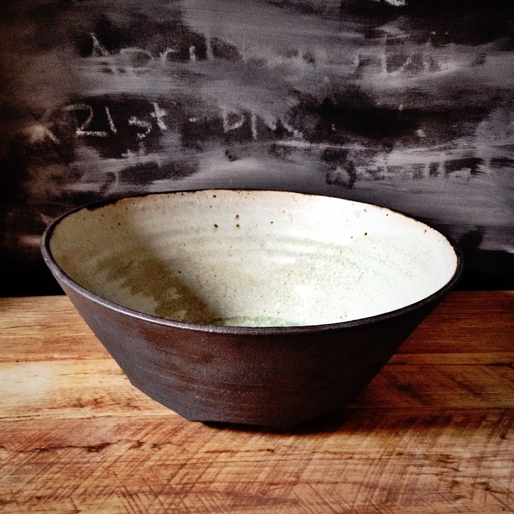 The base of this huge beautiful bowl is carved with Minna's trademark facets.