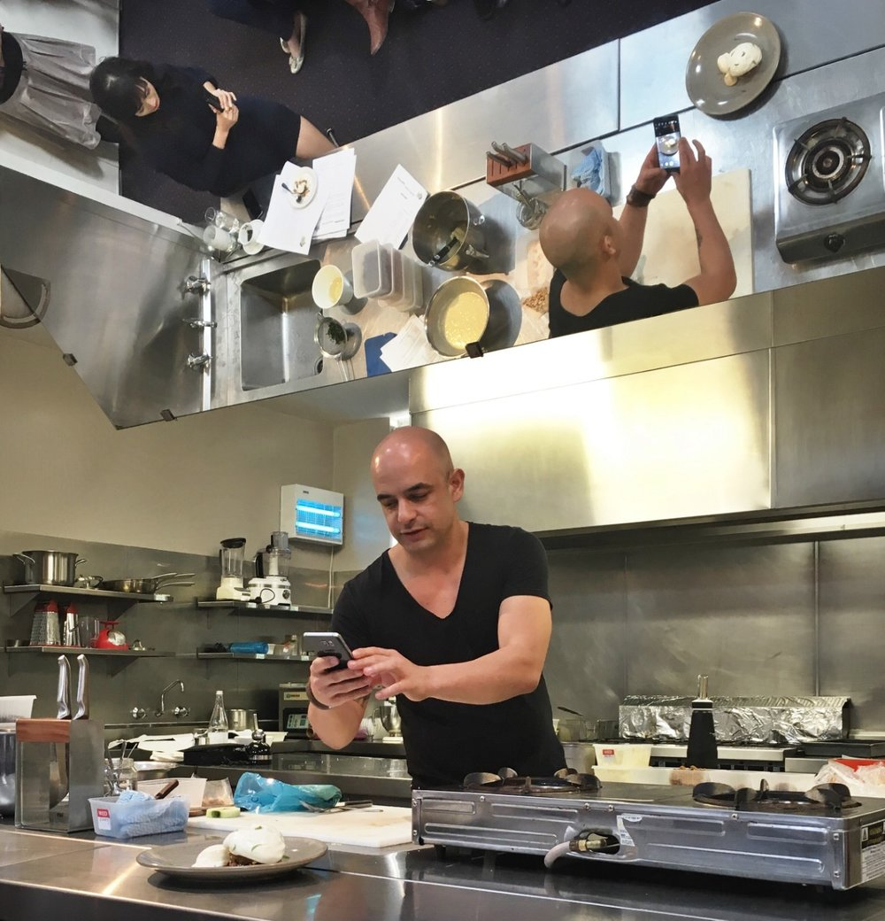 Zumbo taking a photo of his food (we all do it!) - Look in the mirror - can you see his pic?