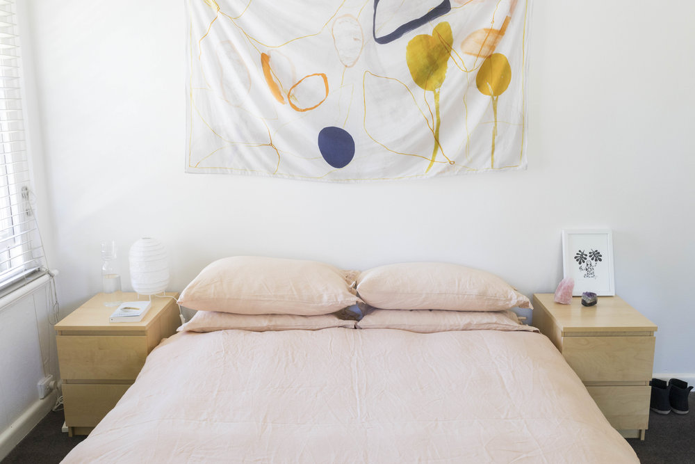 Naturally dyed lined sheets in Belinda Evans' home. Tapestry by Mirador. Photo by Dan Soderstrom for Rented Space.