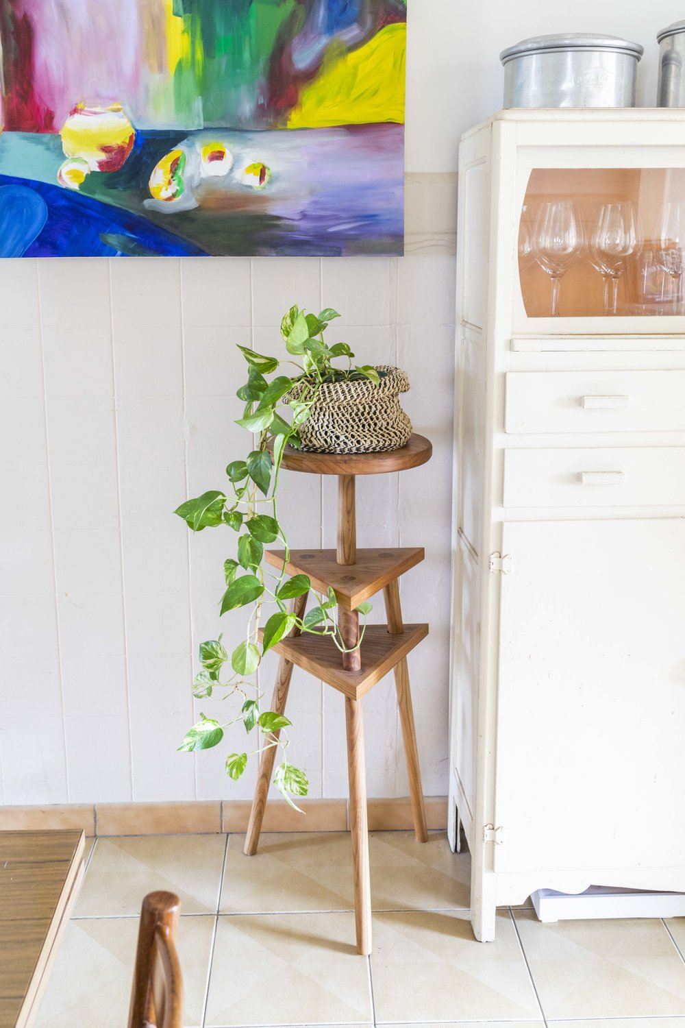 Inside the rented home of Kate Brouwer and Jace Yendall. Timber stand made by Jace. Photo by Dan Soderstrom for Rented Space.