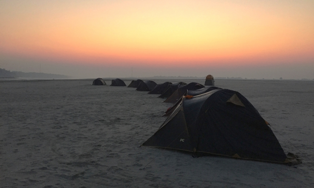 Camping on the banks of the Ganges.
