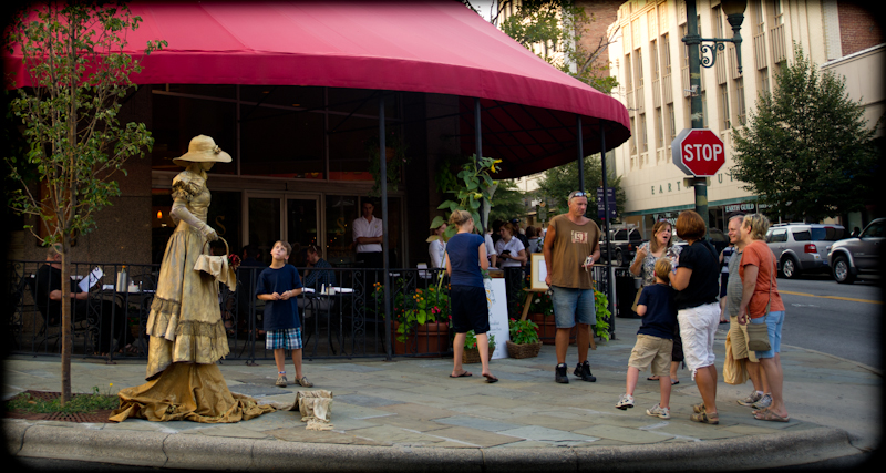 """The """"gold lady"""" in front of Isa's Bistro downtown"""