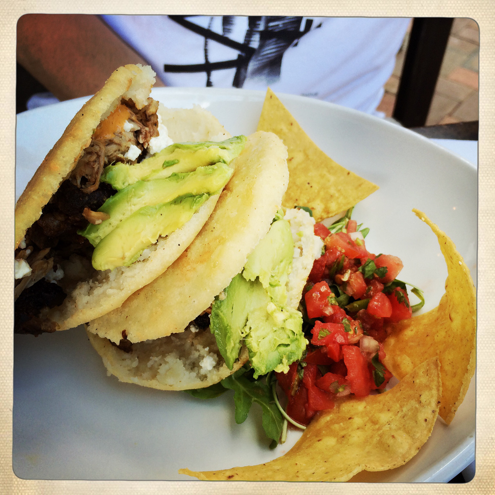 Arepas with pork carnitas and salsa