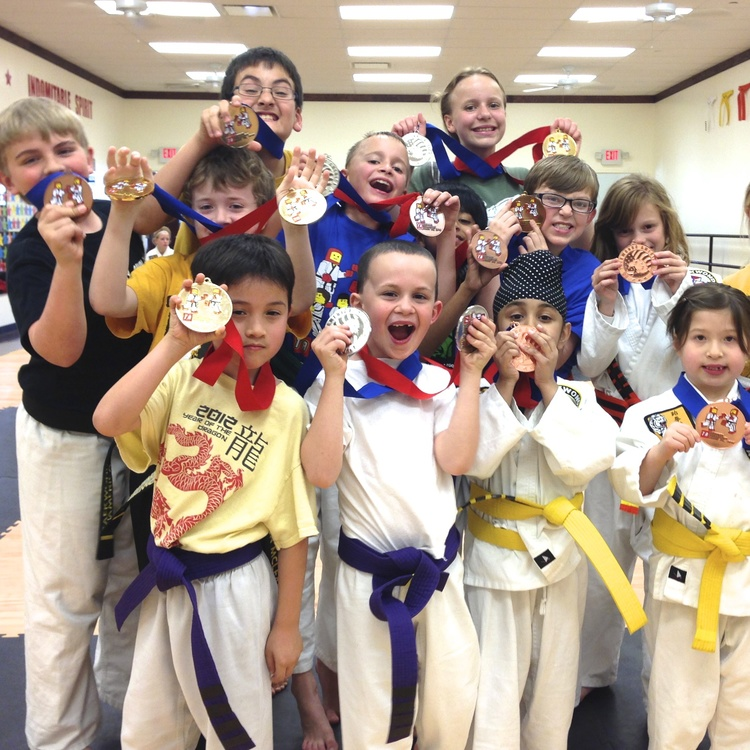 Our karate kids showing off their tournament medals. Great job and congratulations on your big win!