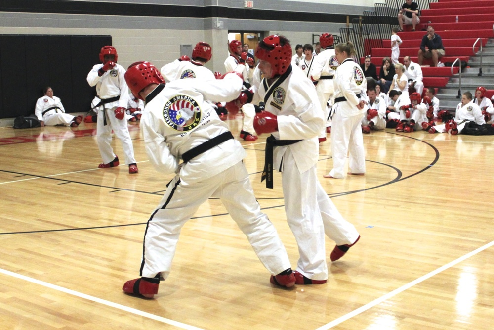 Martial arts students developing self-defense skills through sparring.