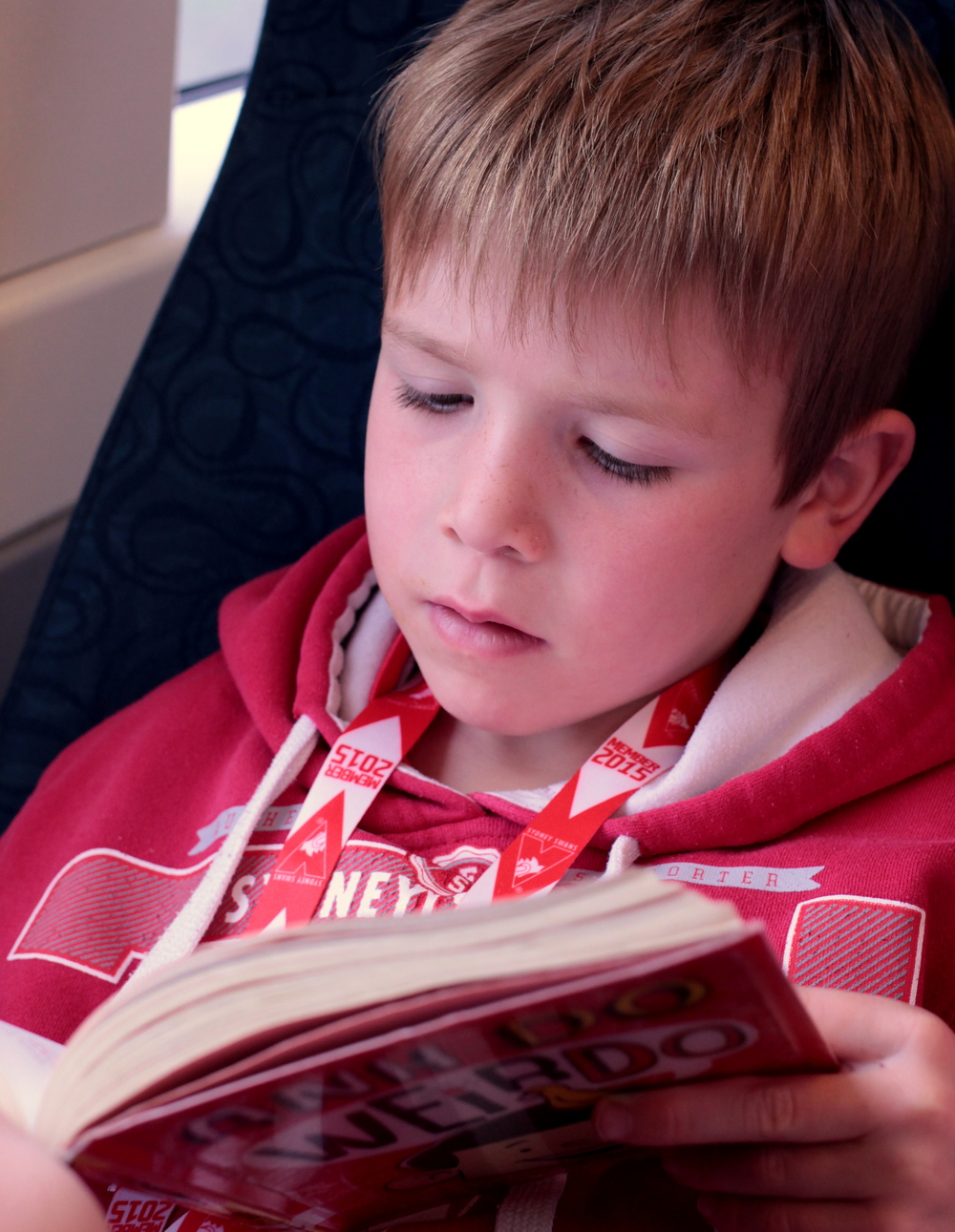 Mr 7 enjoying his book on the train trip. The whole world opens up when you learn to read.