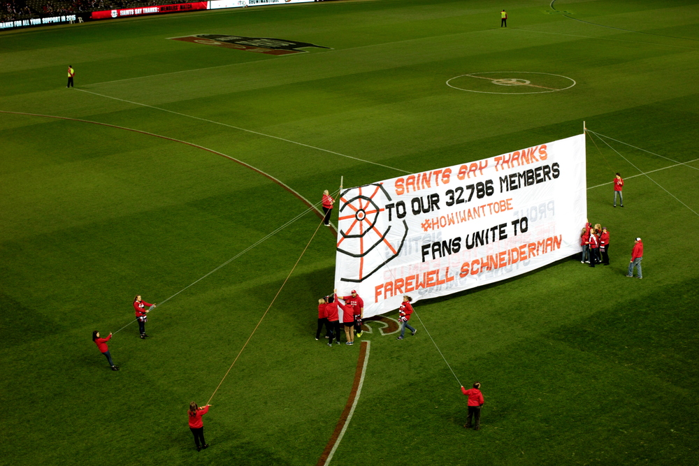 The team banner, made and displayed by the fans, is an AFL tradition. This is St Kilda's banner, ready for the players to run through and on to the field.