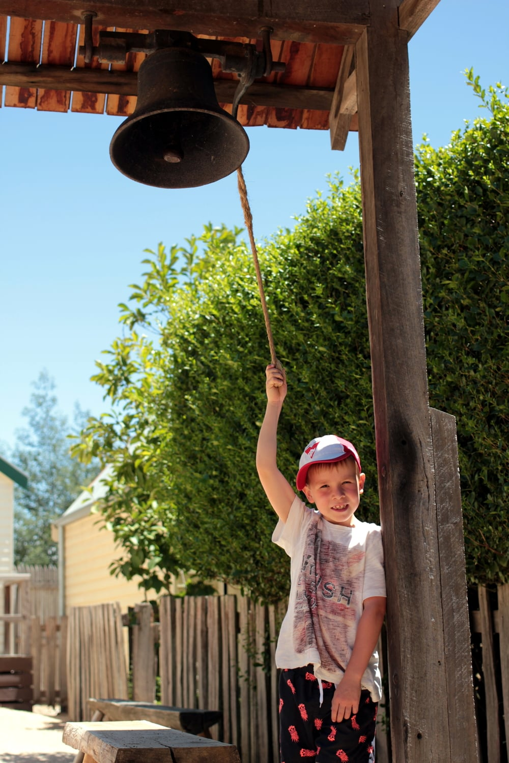 Ringing the school bell.