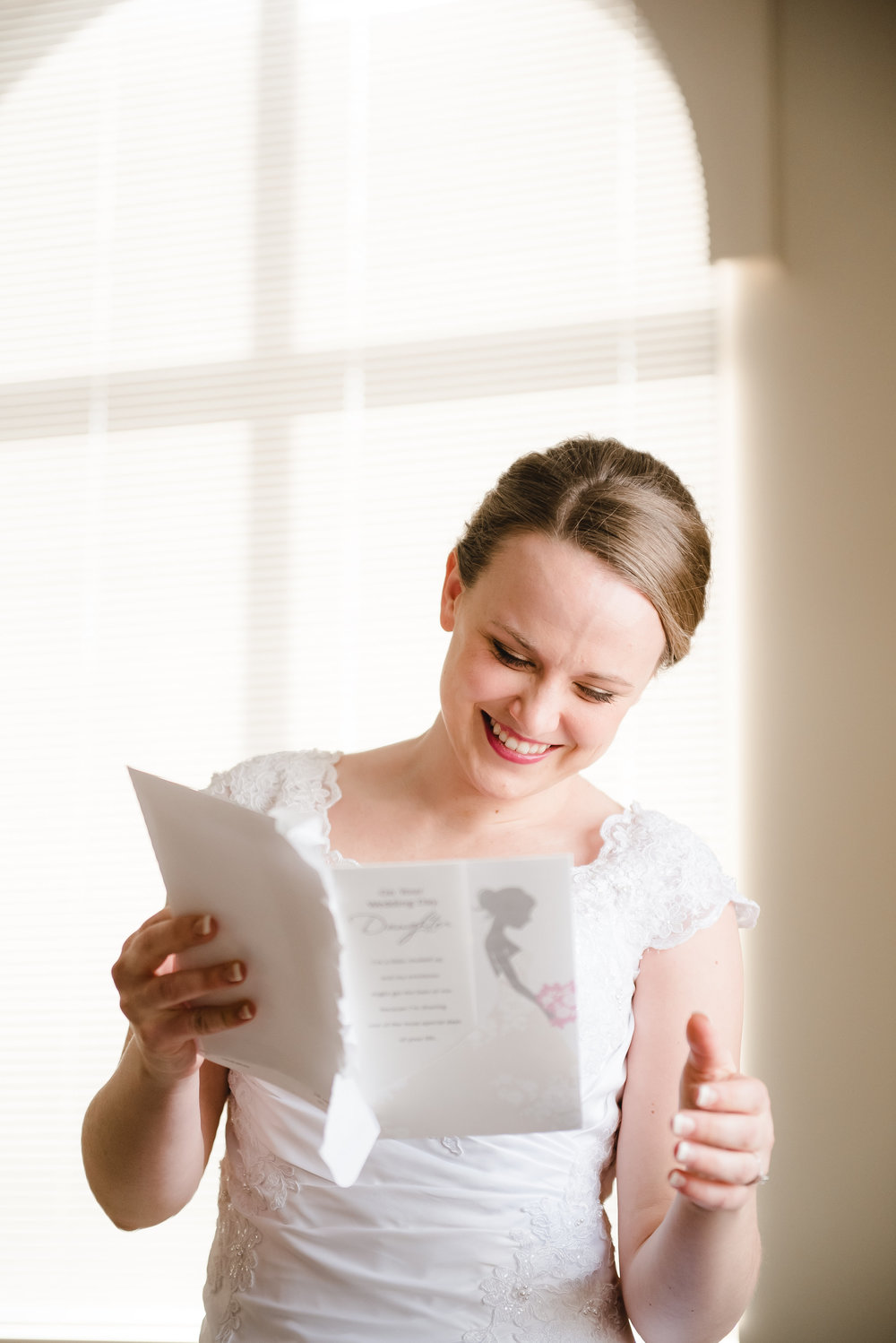 Bride reading card at St. Peter's Catholic Church - Delano, MN Wedding Photography