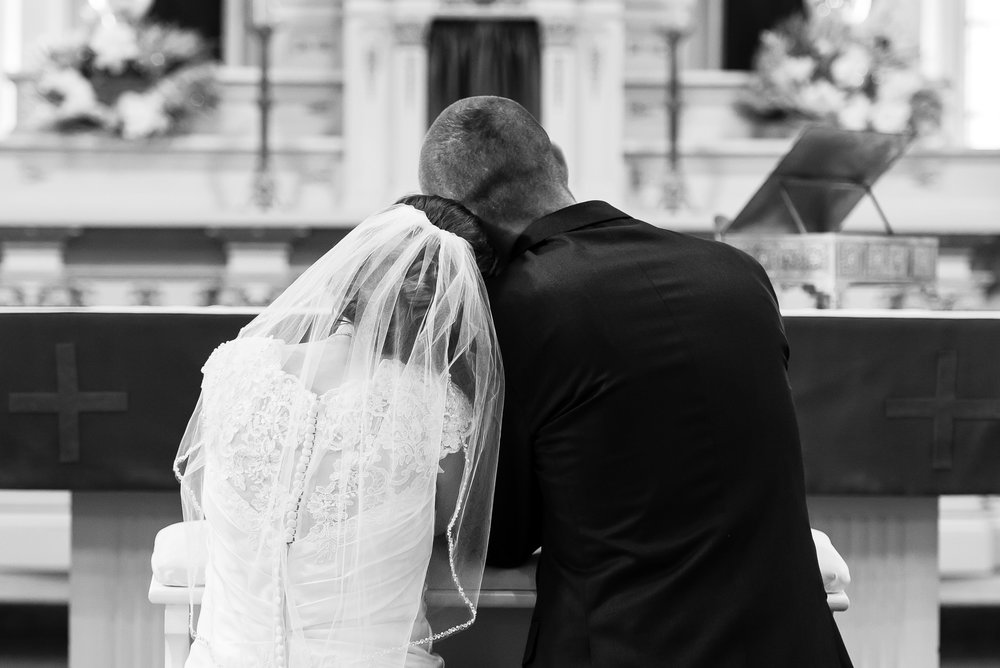 Bride and Groom Kneeling at the Altar - Delano, MN Wedding Photography at St. Peter's Catholic Church