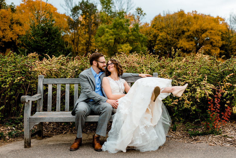 MN Landscape Arboretum Wedding - Bride and Groom on a bench - Twin Cities Wedding Photographer