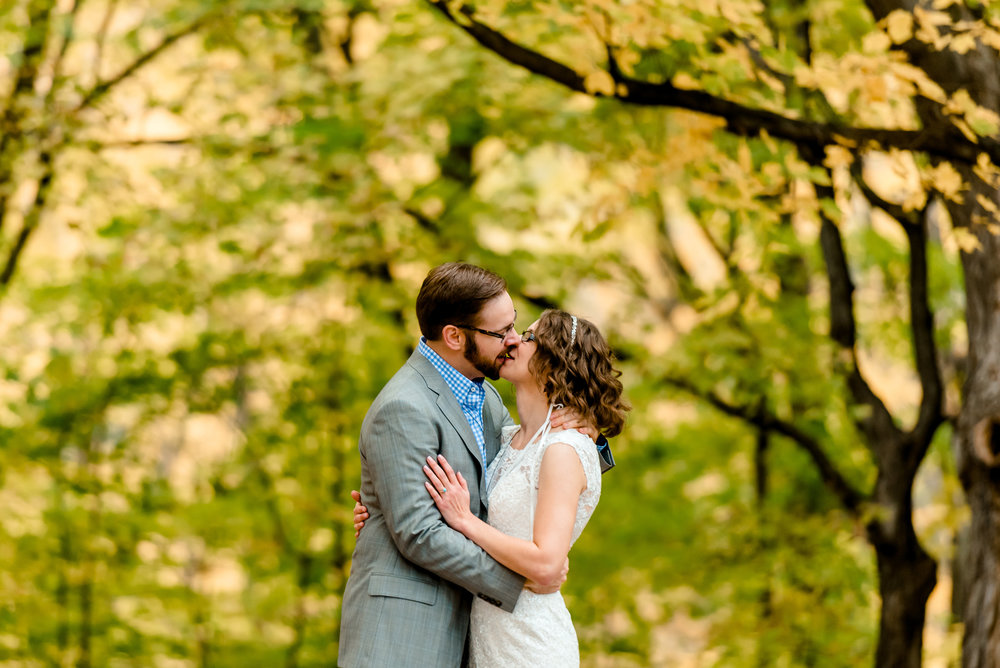 Bride and Groom Kiss under Maple Trees in the Fall at MN Landscape Arboretum - MN Wedding and Engagement Photographer
