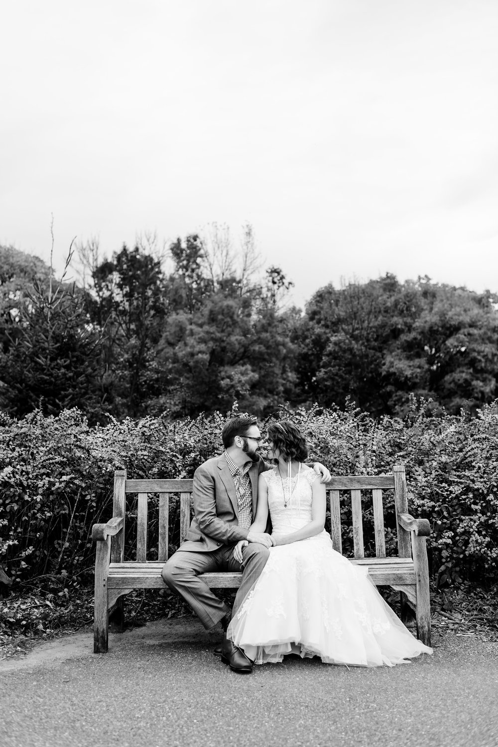 Romantic Bride and Groom Portrait on Bench at Minnesota Landscape Arboretum - Chaska MN Wedding Photographer