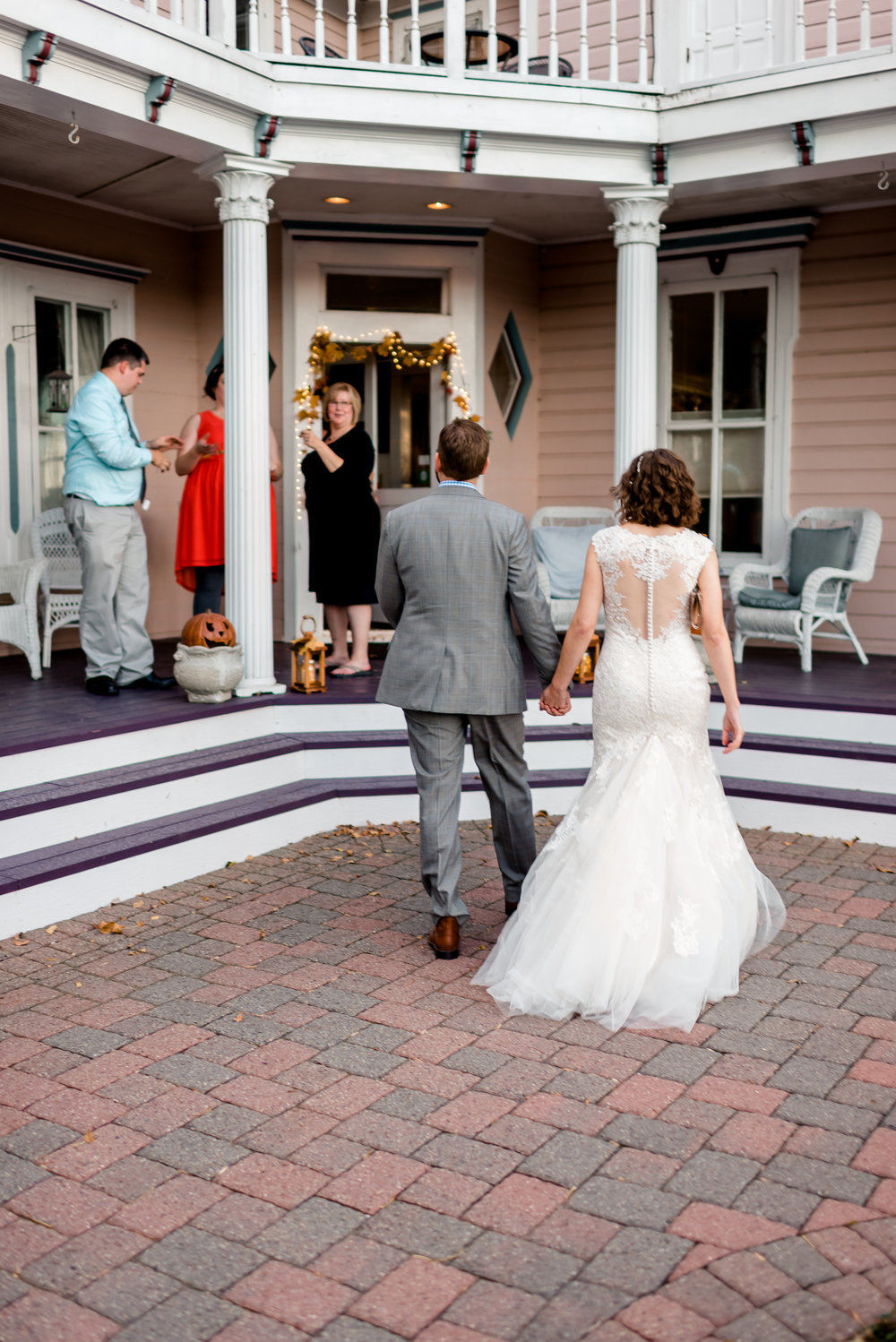 Bride and Groom entering the Bird House Inn in Excelsior MN - Minnetonka MN Wedding Photographer
