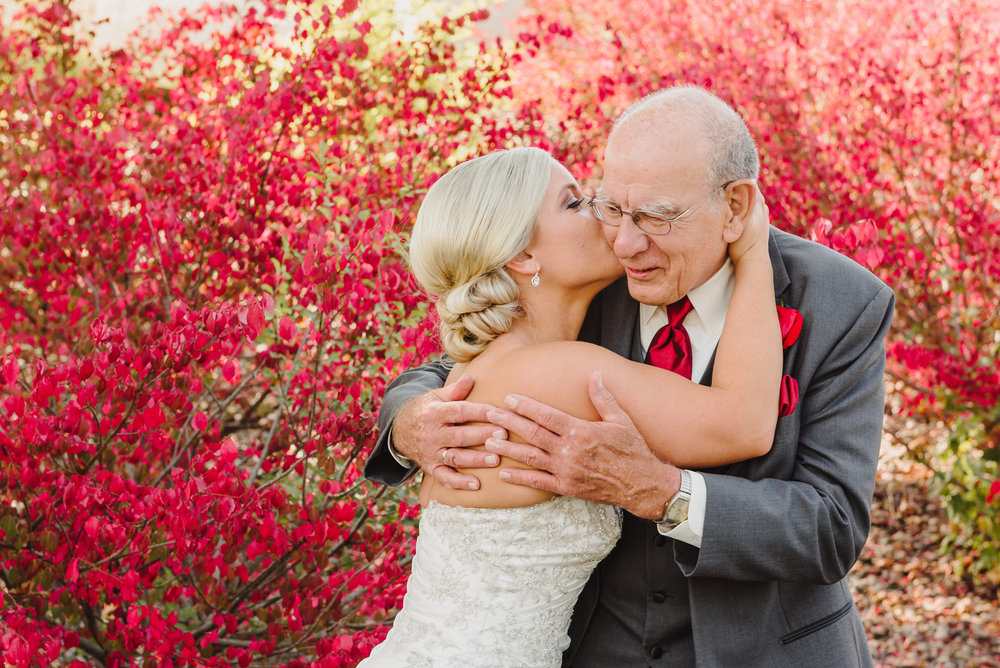 Elderly Wedding Guests and Family - Bride Kisses Grandpa