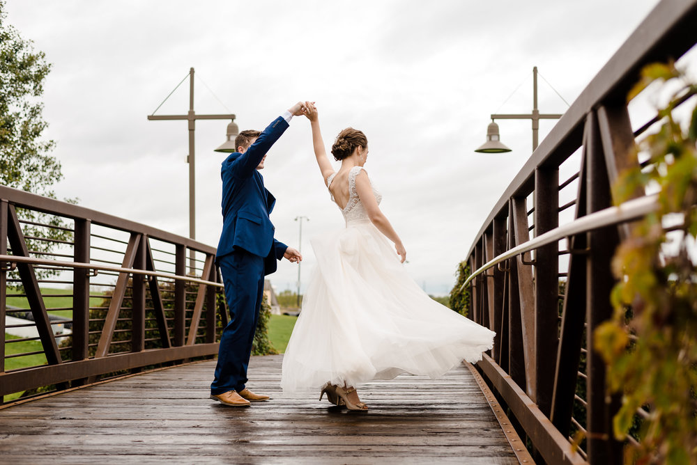 Bride and Groom Dancing on Bridge at Elm Creek Chalet Wedding