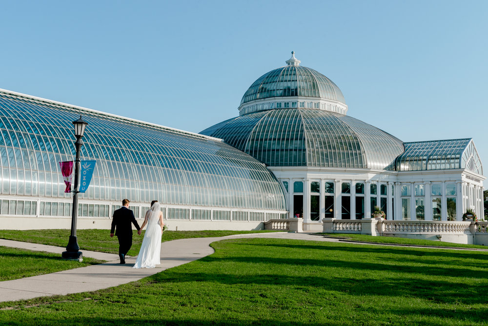 Bride and Groom walk into Marjorie McNeely Conservatory at Como Zoo for Morning Elopement Wedding Ceremony - Minneapolis St. Paul Intimate Wedding Elopement Photographer