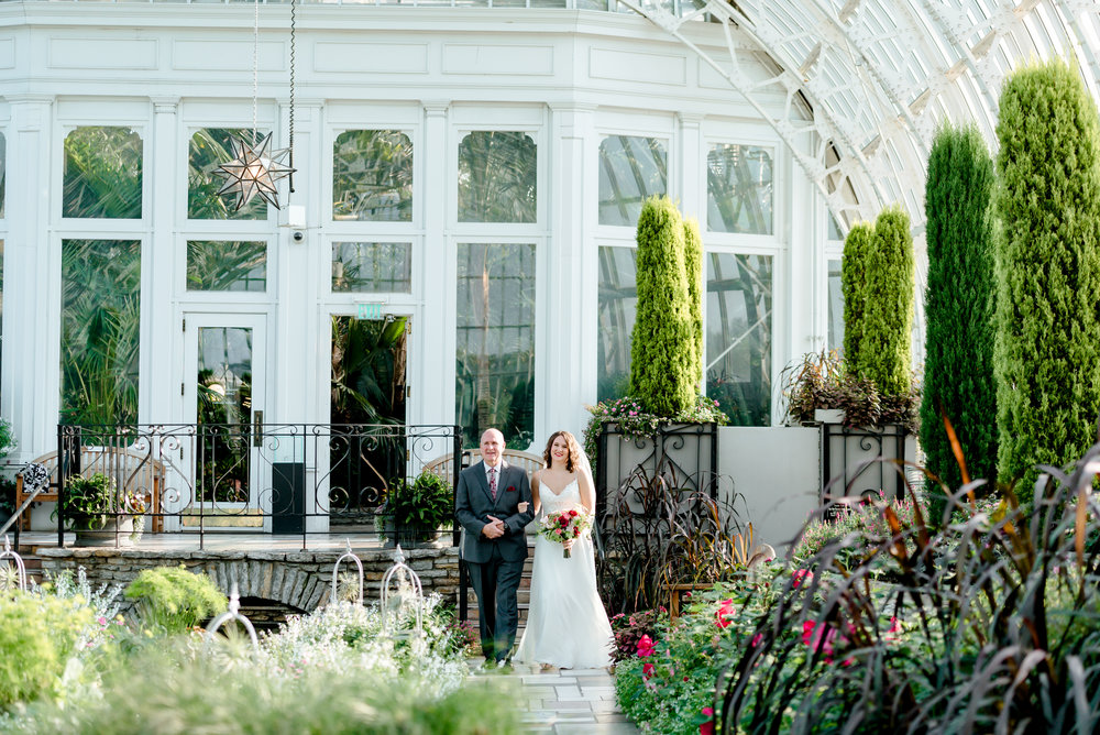 Bride Enters Wedding Ceremony in Sunken Gardens at Como Conservatory - St. Paul Wedding Photographer MN