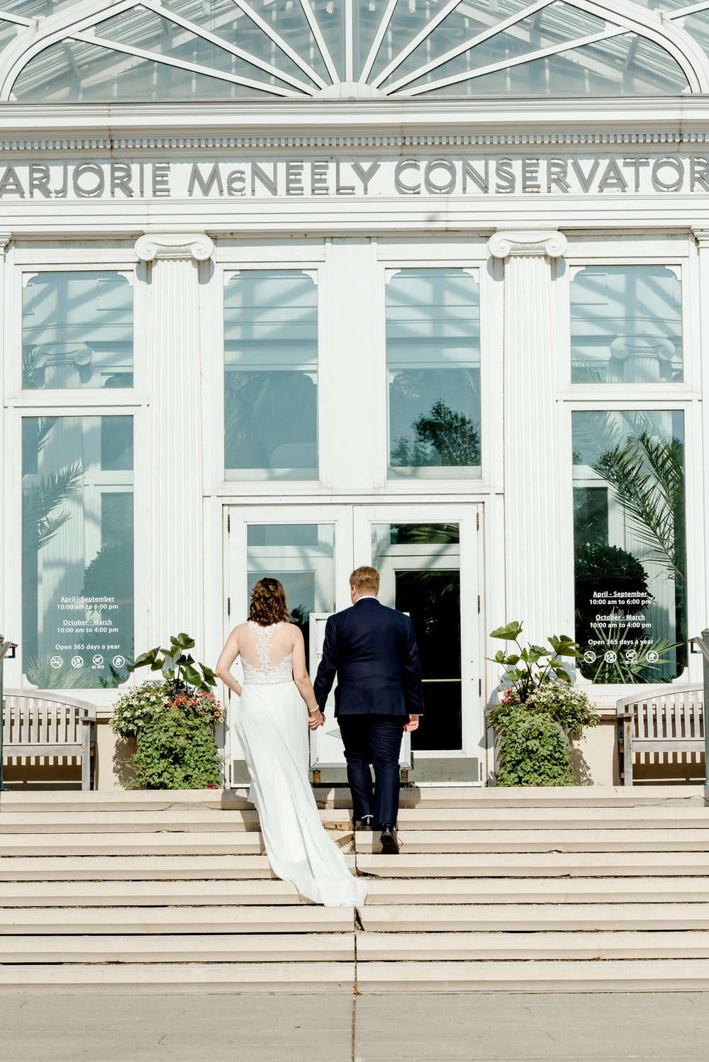 Bride and Groom enter Como Conservatory for Intimate Wedding - St. Paul Wedding Photographer