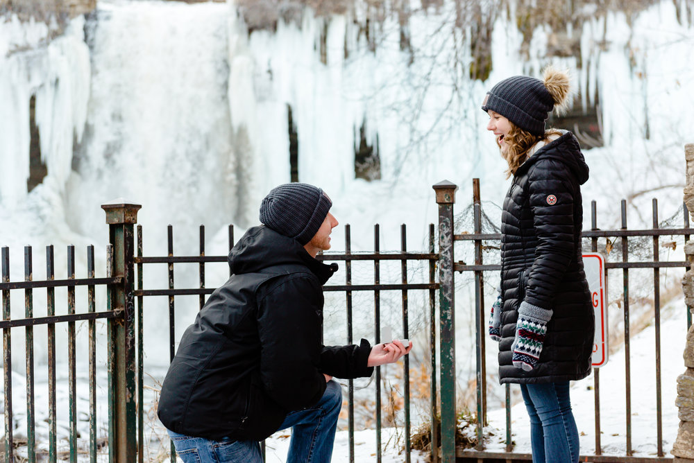 Surprise Marriage Proposal in the Winter at Minnehaha Falls - Frozen Waterfall Proposal - Best Engagement Photos in MN