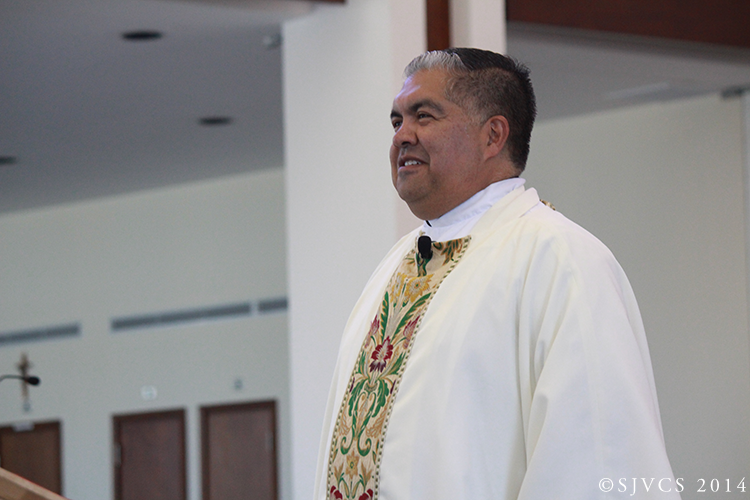 Rector Msgr. Garza delivers his homily
