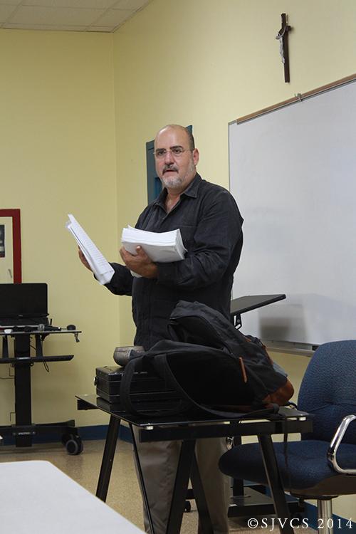 Fr. Robert Vallee distributes handouts