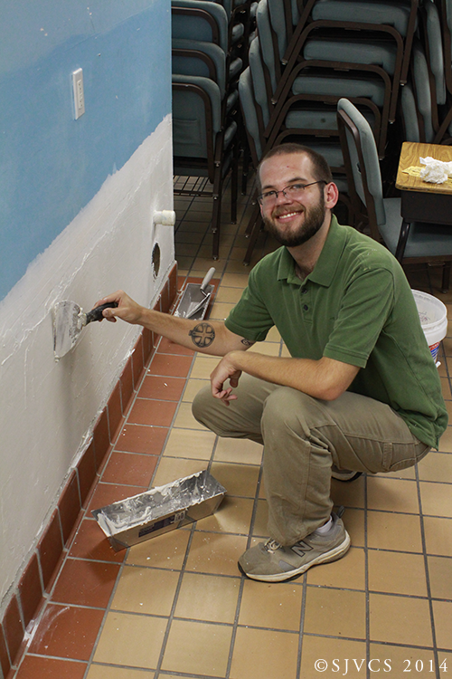 Pre-theologian Brent Gordon helps repair a wall