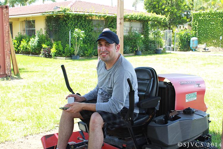 Carlos Garcia cuts the lawn